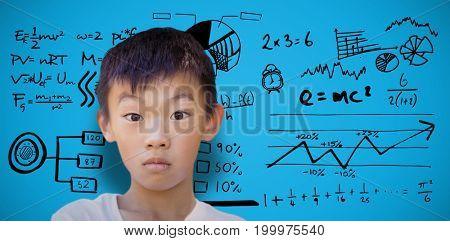 Portrait of shocked boy against blue background