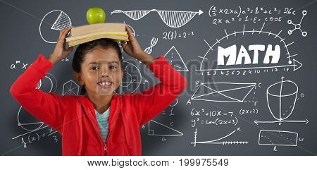 Girl carrying books and apple on head against dark grey background