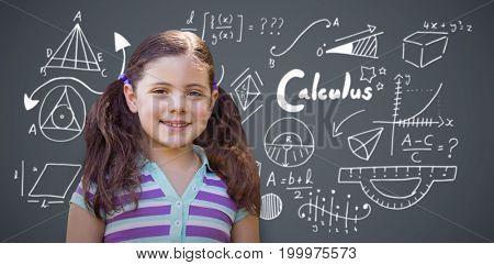 Portrait of smiling girl against dark grey background