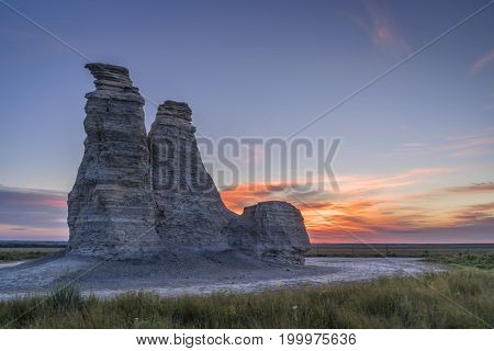Castle Rock against sunrise - limestone pillar landmark in prairie of western Kansas near Quinter (Gove County) , late summer morning