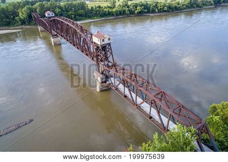 Historic railroad Katy Bridge  over Missouri River at Boonville with a lifted midsection and visitor observation deck  - aerial view