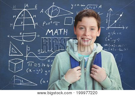 Portrait of smiling innocent boy against mathematics text with geometric shapes