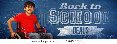 Portrait of boy sitting in wheelchair against blue background