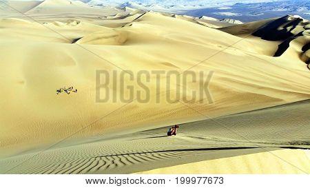 Body boarding Huacachina sand dunes in Peru