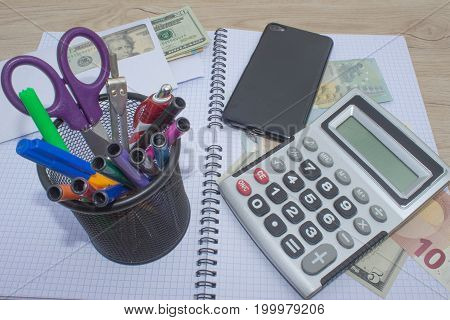 analysis of the annual budget with calculator and money on the table. financial concept. Business Objects in the office on the table