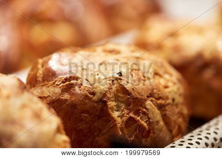 food, cooking and baking concept - close up of yeast bread, bun or pie at bakery