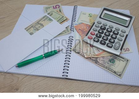 Calculator and money thai banknote on wooden table. The concept of financial planning savings. Business Objects in the office on the table