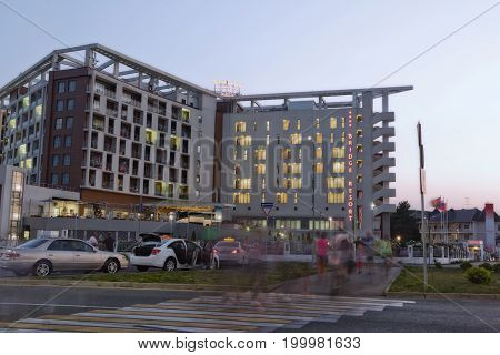 Evening Light On The Sidewalks And Illumination Of Buildings In Bridge Resort