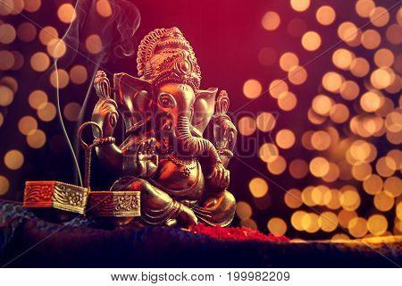 lord ganesha statue on blurred bokhe background