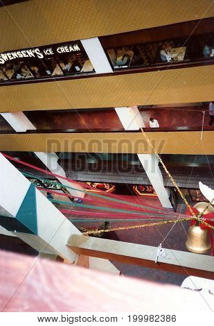 SINGAPORE - CIRCA 1990: A view inside Singapore's Plaza Singapura shopping mall, which is festively decorated for Christmas.