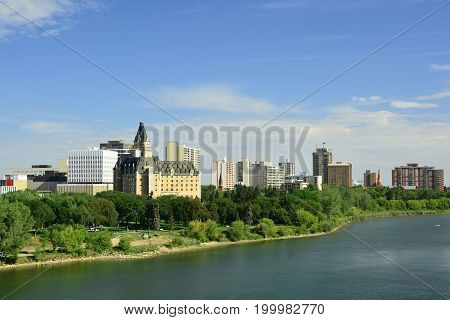 Saskatoon Saskatchewan,August 11th 2017.The skyline of Saskatoon with the South Saskatchewan river that runs through it and the iconic Bessborough Hotel in the foreground.