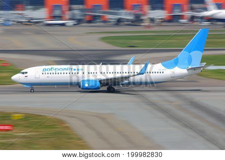 Sheremetyevo, Moscow Region, Russia - August 6, 2014: Dobrolet Boeing 737-800 VQ-BTG taking off at Sheremetyevo international airport.