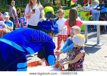 Chernihiv / Ukraine. 06 May 2017: Happy children are glad of blowing bubbles. Family have a rest in the Chernihiv town in the spring. 06 May 2017 in Chernihiv / Ukraine.