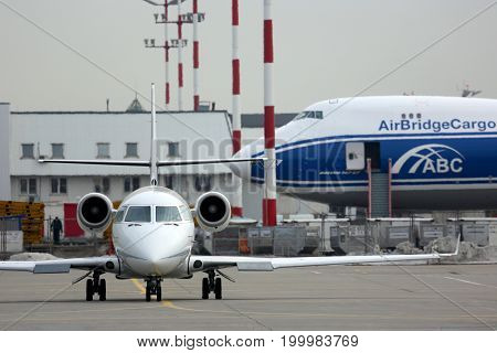 Sheremetyevo, Moscow Region, Russia - March 2, 2014: Private Gulfstream G200 LX-GRS pictured at Sheremetyevo international airport.