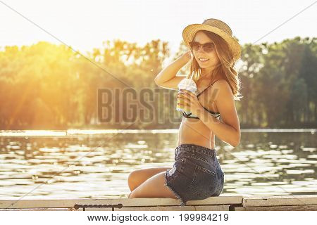 Attractive Young Beach Girl On Wooden Pier.