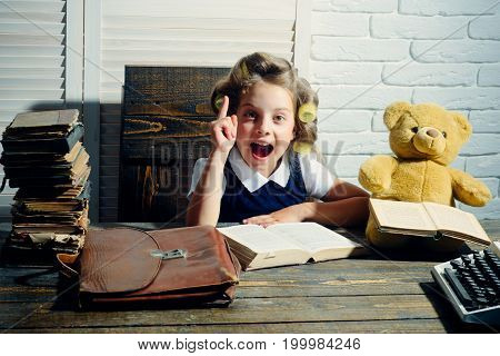 Child Read Book With Briefcase And Retro Typewriter