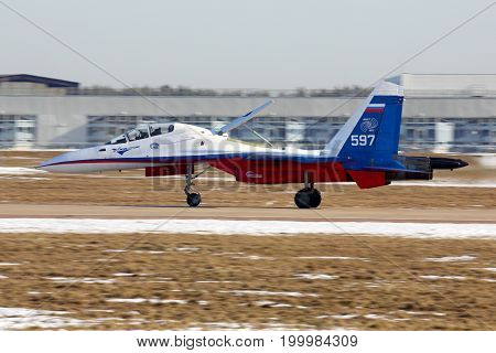 Zhukovsky, Moscow Region, Russia - March 2, 2014: Sukhoi Su-30M 597 WHITE of Flight Research Institute perfoming test flight at Zhukovsky.