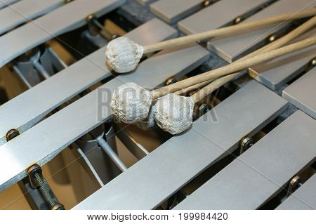 xylophone, musical percussion instrument concept - closeup on wooden beige bars with mallets, glockenspiel, marimba, balafon, semantron, pixiphone, education and orchestra concert usage