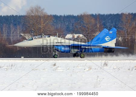 Zhukovsky, Moscow Region, Russia - January 12, 2014: Mikoyan Gurevich MiG-29LL 84 BLUE jet fighter of flight research institute landing at Zhukovsky.