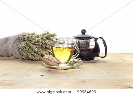 Herbal tea in a glass cup on a table closeup