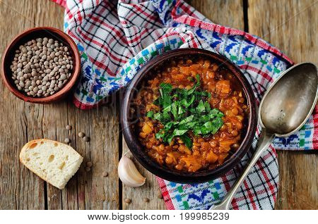 Cabbage Lentil stew on a wood background
