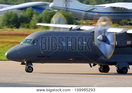 Chkalovsky, Moscow Region, Russia - July 18, 2013: Antonov An-140 RA-41258 of Russian Air Force taxiing at Chkalovsky.