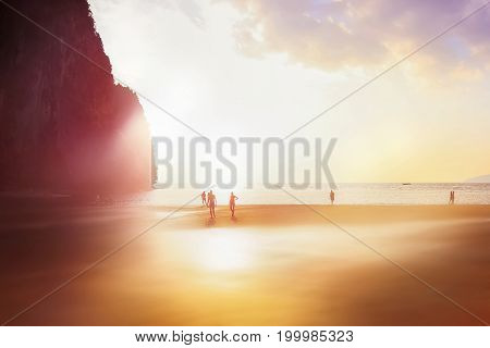 Silhouettes of people in the sunlight on the beach. Sunset on the beach in the province of Krabi. Railay Beach. Thailand. Soft light effect artistic image.