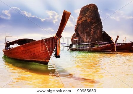 Traditional Thai tourist boats on the Railay beach. Province of Krabi. Thailand.