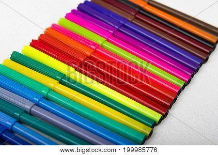 A Lot Of Colored Pencils, Markers, Pens, White Background, Row Markers Colored Yellow, Blue, Red, Co