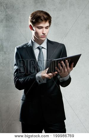 Portrait Of Young Businessman With Touch Screen Computer