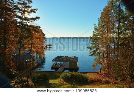 boat house on a lake in Autumn