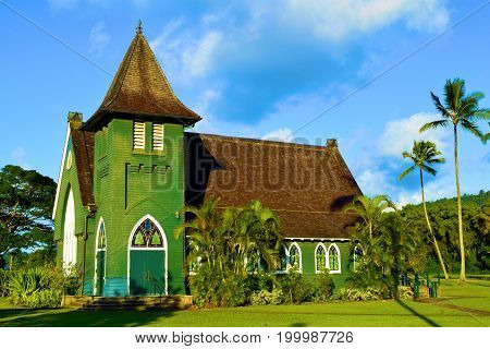 Waioli Huiia Mission Church which was built by missionaries in 1843 surrounded by lush green manicured gardens taken at Hanalei Bay in Kauai, HI