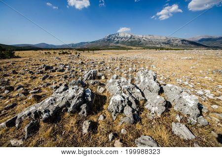 Photo of fields under Dinara mountain in Croatia