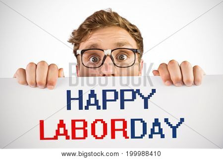 Geeky hipster showing a card against labor day text