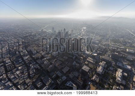 Downtown urban Los Angeles hazy summer afternoon aerial in Southern California.