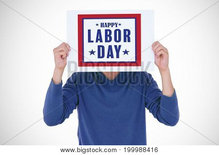 Man holding blank sign in front of face against composite image of happy labor day poster