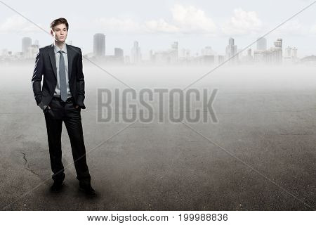 Young  Businessman Standing Over City Background