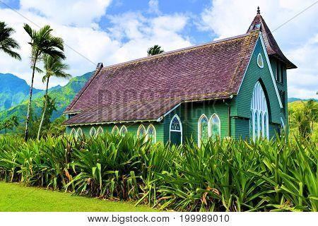 Historic Waioli Huiia Church built in 1843 when missionaries first settled in Hawaii taken at Hanalei Bay in Kauai, HI
