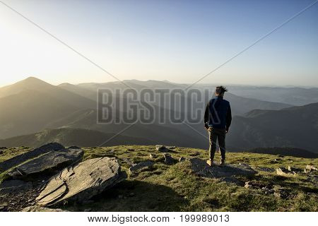 Man is feeling freedom in the top of the mountian