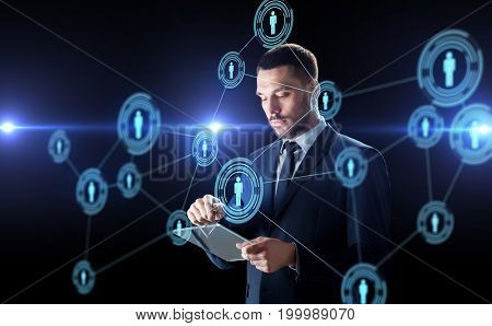 business, human resources and modern technology concept - businessman working with transparent tablet pc computer and with virtual network contacts over black background