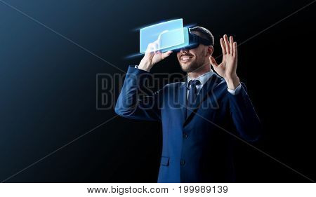 business, people and future technology concept - smiling businessman in headset over black background with virtual screen