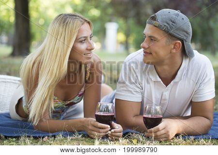 Young Couple In Love Enjoying In Nature While Drinking Wine
