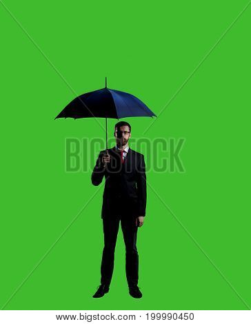 Businessman with umbrella standing over chroma key background. Business, career job concept.