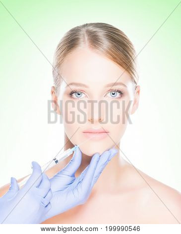 Woman getting face injection therapy. Lifting and plastic surgery concept.