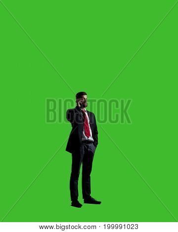 Businessman with smartphone standing over chroma key background. Business, career job concept.