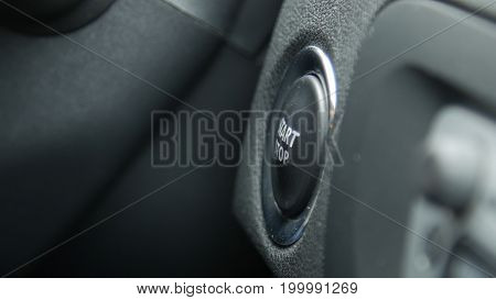 Close up of engine start and stop button of a car.