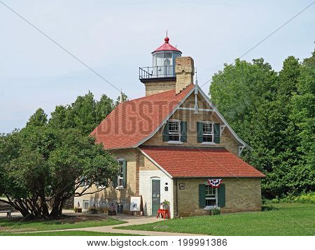 Built in 1868 on a bluff above Green Bay and still operational Eagle Bluff Lighthouse is located near Ephraim in Door County Wisconsin in what is now Peninsula State Park.