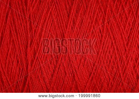 Red texture of a wool of thick woolen thread