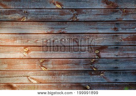 Brown scratched wooden board with light at left corner. Wood texture