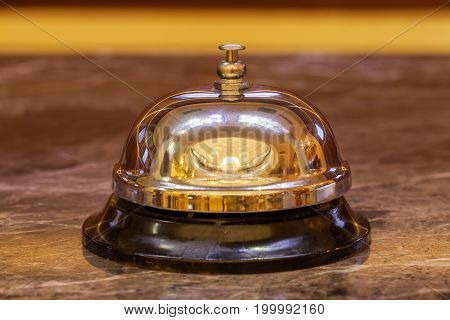 Old Hotel Bell On A Marble Stand